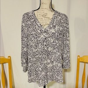 Cheetah print blouse with buckle pockets.